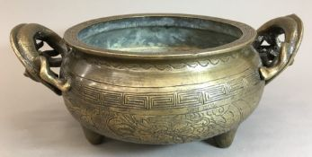 A Chinese cast bronze censer With twin dragon handles, the body with incised decoration,