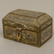 A 19th century Islamic Cairo ware mixed metal inlaid brass casket Of hinged domed rectangular form.