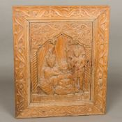 A 19th century Tibetan carved wooden panel Depicting Buddhist figures. 43.5 cm wide.