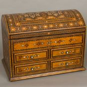 A late 19th /early 20th century North African mother-of-pearl and specimen wood inlaid chest The