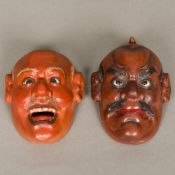 A pair of late 19th century Japanese lacquered masks of Noh Each of male form, set with glass eyes.