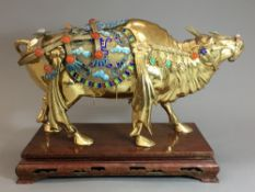 A Chinese Republic period 925 silver and gold washed figure of an ox Finely adorned with coloured