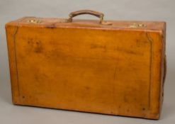 A good quality early 20th century leather covered suitcase Of typical rectangular form with brass