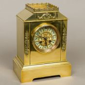 A 19th century French brass cased mantle clock by A D Mougin The ivory coloured sectional dial with