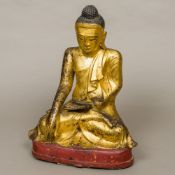 A large 18th century Chinese gilt bronze Buddha Typically modelled,