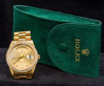 An 18K gold gentleman's Rolex Day-Date oyster perpetual wristwatch The diamond set bezel enclosing