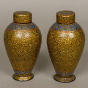 A pair of 19th century Persian papier mache lidded vases,