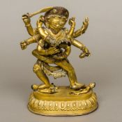 A gilt bronze model of a Tibetan multi-armed tantric deity Modelled holding various objects,