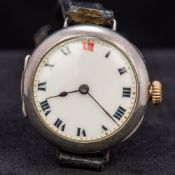 An early 20th century gentleman's silver cased Rolex trench watch The white enamelled dial with