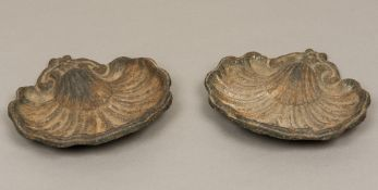 A pair of 19th century cast metal garden statuary decorations Scallop shell cast. 25 cm wide.