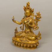A gilt bronze model of Buddha Modelled seated in the lotus position,
