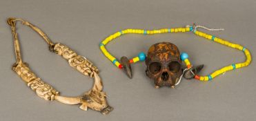 Two North East Indian/North West Myanmar Naga tribe necklaces One carved from bone,