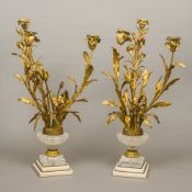 A pair of gilt bronze and rock crystal candelabra Of floral urn form,