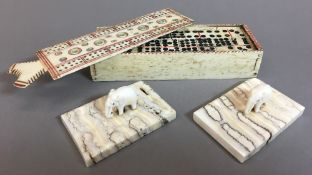 An early 19th century carved and polychrome decorated whale bone box enclosing dominoes The sliding