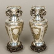 A pair of late 19th century Chinese unmarked silver and silver gilt vases Each flared neck rim