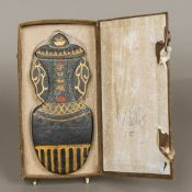 A Chinese ink block Formed as a vase and cover decorated with gilt heightened calligraphy, boxed.