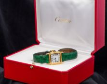 An 18 ct gold Cartier lady's wristwatch The square shaped white dial with Roman numerals inscribed