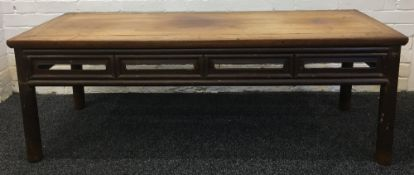 A 19th century Chinese elm low table The cleated rectangular top above the pierced frieze,
