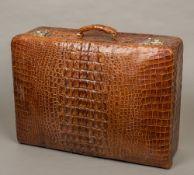 A vintage crocodile skin suitcase