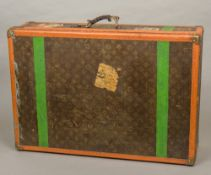 A vintage Louis Vuitton travelling case Typically decorated in the LV livery with brass fittings,