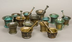 A collection of bronze pestles and morta