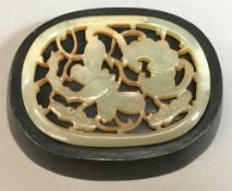 A small Chinese pierced jade panel