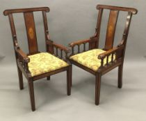 A pair of late Victorian/Edwardian inlaid mahogany and beech open armchairs Each crossbanded curved