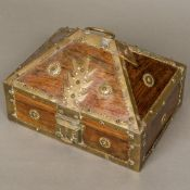 A 19th century brass mounted wooden casket Of hinged domed form, with brass latch,