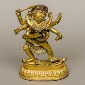 A gilt bronze model of a Tibetan multi-a