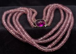 A French silver mounted amethyst glass b
