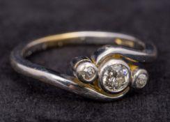 An 18 ct white gold three stone diamond