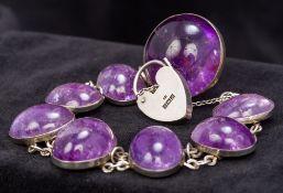 A cabochon amethyst set silver bracelet