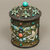 A Chinese silver enamel decorated lidded box The domed removable lid enclosing the jade interior,