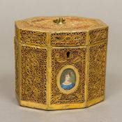 An early 19th century rolled paper tea caddy Of octagonal hinged form,