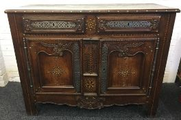 An 18th century French polished steel and brass mounted inlaid chestnut buffet The moulded