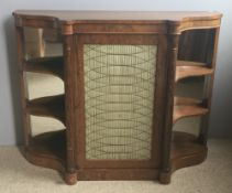 A Regency rosewood side cabinet The shaped top above the brass grille centred cupboard door flanked