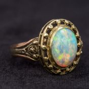 An unmarked bi-colour gold opal ring