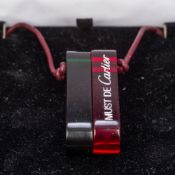 Two Must de Cartier pendants