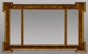 A walnut framed over mantel mirror With triptych plate. 113 cm wide.