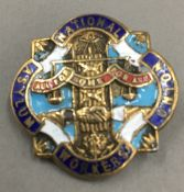 An enamelled National Asylum Workers Union badge