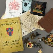 A quantity of military badges, etc.