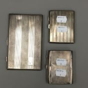 Three silver cigarette cases