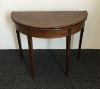 A 19th century mahogany demi-lune tea table