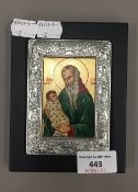 A Greek icon of a bearded saint within a silver frame