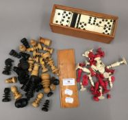 A 19th century carved and stained bone chess set,