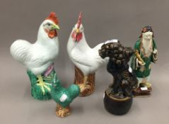 Five pieces of antique Chinese porcelain; three cockerels,