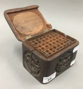 An Eastern carved wooden cigarette box