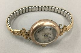 A ladies gold watch (23.