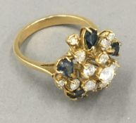 An 18 ct gold diamond and sapphire set ring,