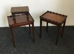 A small oak stool and two side tables